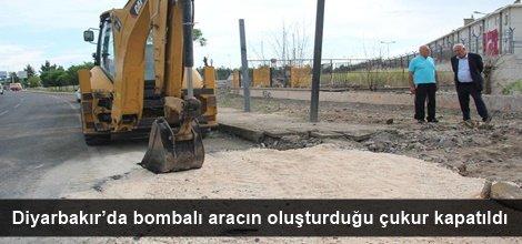 Diyarbakır'da bombalı aracın oluşturduğu çukur kapatıldı video foto