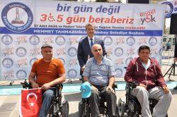 Engellilere akülü sandalye dağıtıldı