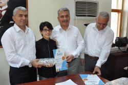 Tarsus'ta başarılı öğrenciler ödüllendirildi foto