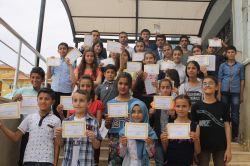 PKK'nin İdil'de tahrip ettiği okulda karne heyecanı