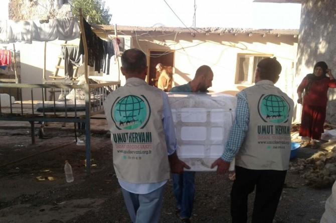 Umut Kervanı'ndan Bismil'de muhtaç aileye beyaz eşya yardımı