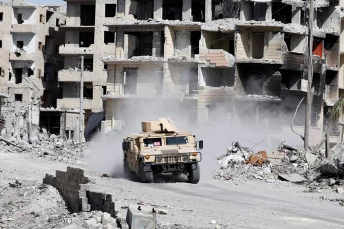 Rakka'da 2371 insan katledildi, yarım milyon insan da yerinde edildi