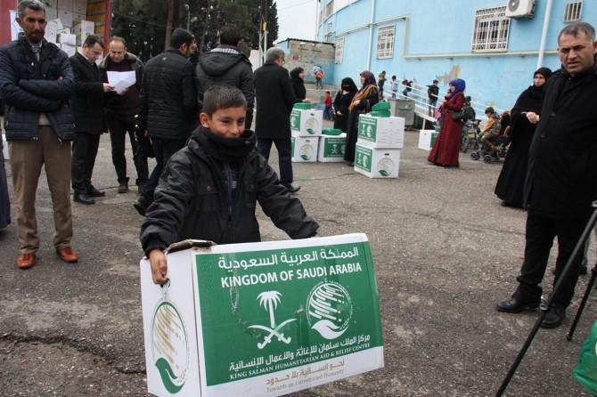 Suriyeli bin aileye kışlık malzeme dağıtıldı