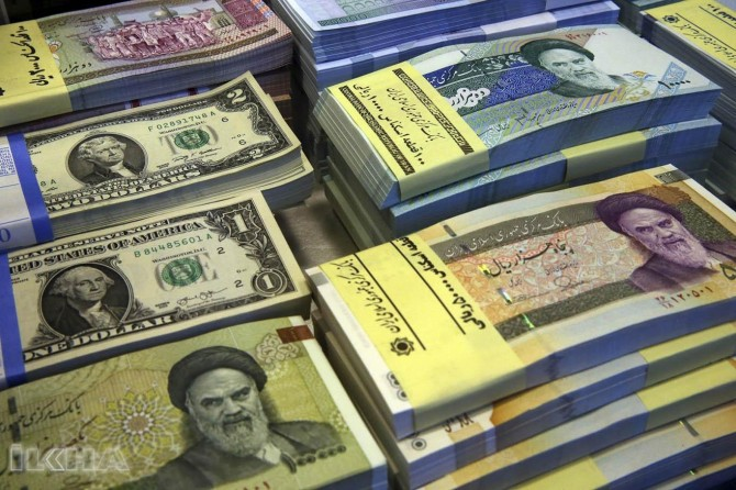 Iran bans imports via dollars