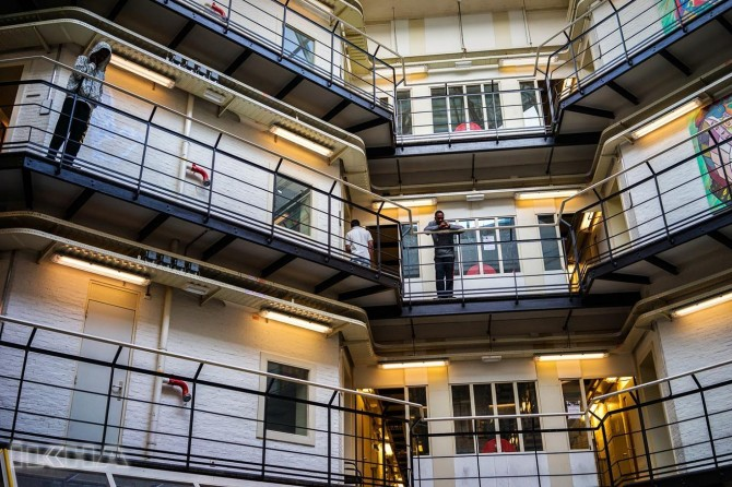 Dutch settles refugees into empty prisons