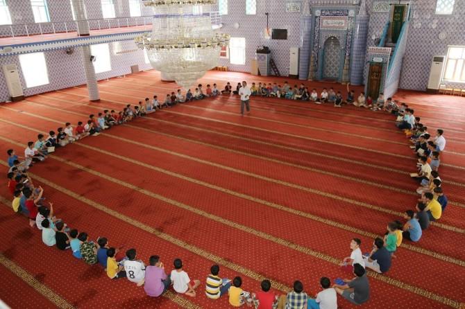 Divê em zarokên xwe bi Qur'anê mezin bikin