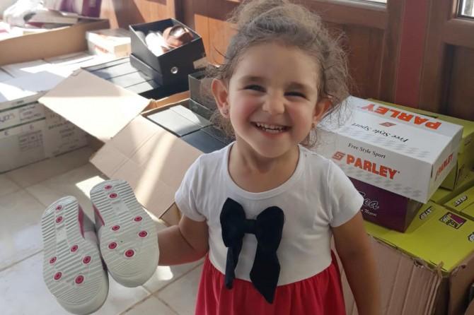 Mardin'de yetim ve muhtaçlara giyecek yardımı