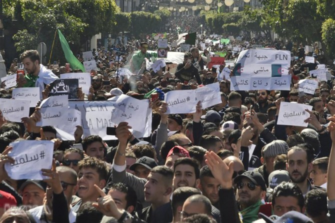 Tens of thousands march against Bouteflika in Algeria