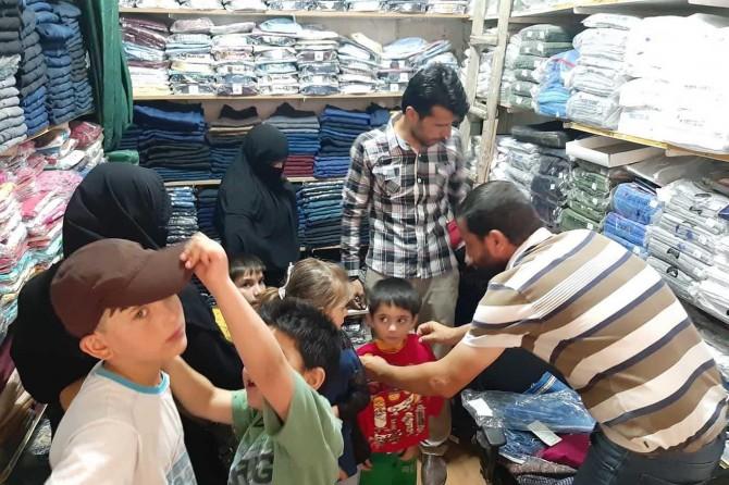 Mardin'deki yetimlere bayramlık giydirildi