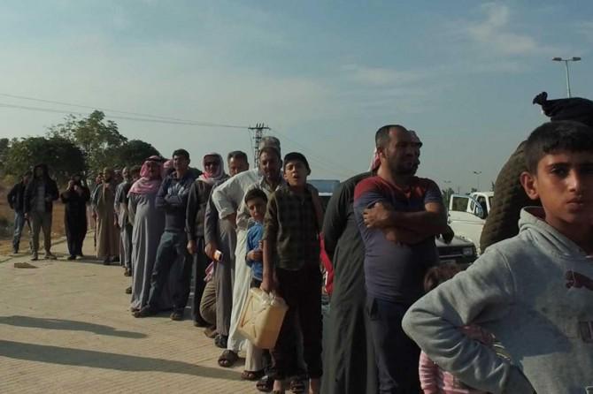 Tel Abyad halkına yardım dağıtıldı