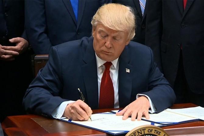 Trump, Çinli yetkililere yaptırım uygulanmasını içeren yasa tasarısını onayladı