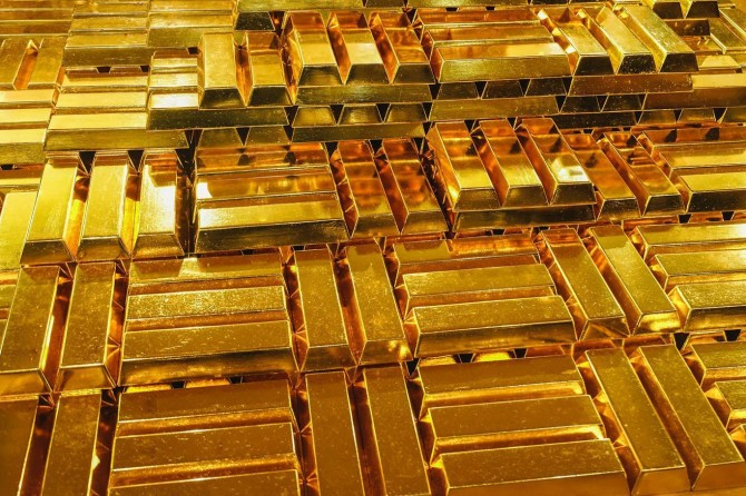 Gold prices hit record highs as investors hunting for safe haven assets