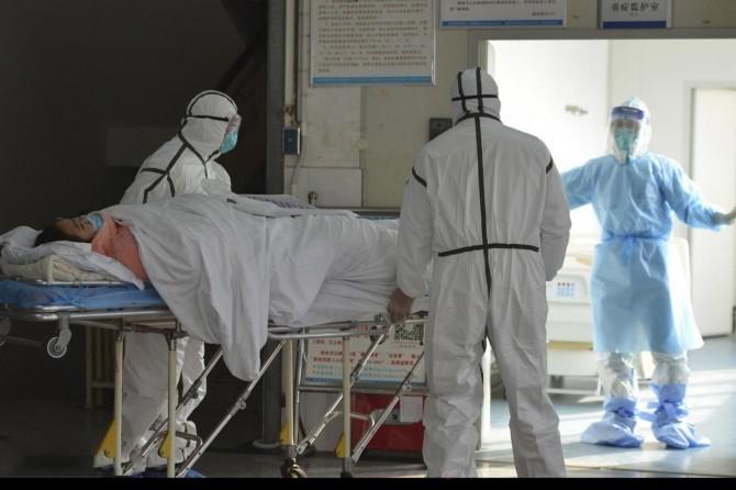 ABD'de Covid-19 nedeniyle ölenlerin sayısı 165 bin 92'ye yükseldi