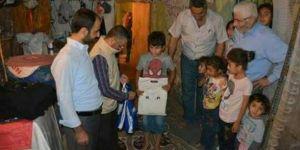 Umut Kervanından 200 ihtiyaç sahibi çocuğa ayakkabı yardımı
