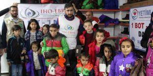 IHO-EBRAR ve Yetimler Vakfı'ndan çocuklara kışlık yardımı