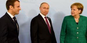 Putin, Merkel ve Macron'la Suriye'yi görüştü