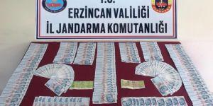Kemaliye'de yüklü miktarda sahte para ve banka çeki ele geçirildi