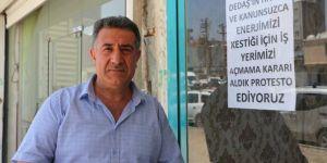 Elektriği kesilen esnaf DEDAŞ'ı protesto ediyor
