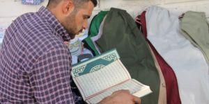 Kuran-ı Kerim okuyarak vaktimi değerlendiriyorum