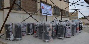 Tel Abyad ve Resulayn'daki okullara STK'lardan soba yardımı