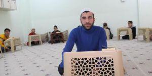 Diyarbakırlı genç, hizmetli olarak görev yaptığı Kur'an kursunda hafız oldu