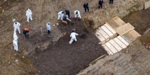 ABD'de Coronavirus'ten ölenler toplu mezarlara gömülüyor