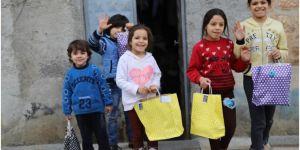 Kilis'te bin 500 yetim aileye iftariye verilip çocuklara oyuncak dağıtıldı