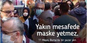 Bakan Koca, pazar yerindeki bir fotoğrafı paylaşarak maske ve sosyal mesafe uyarısı yaptı