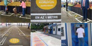 Adana'da semt pazarlarında ve ATM önlerinde sosyal mesafe işaretlemesi sürüyor